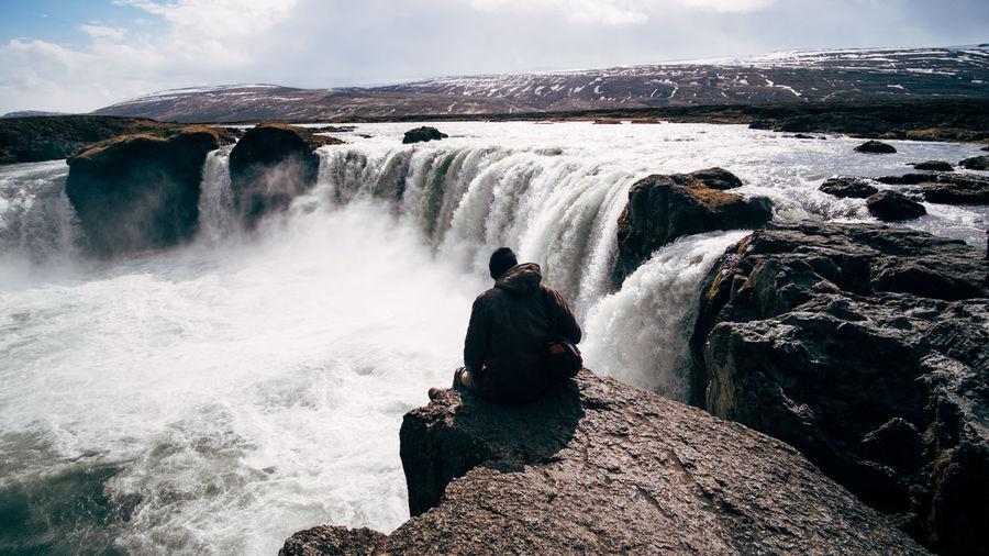 Rear view of waterfall against rocks