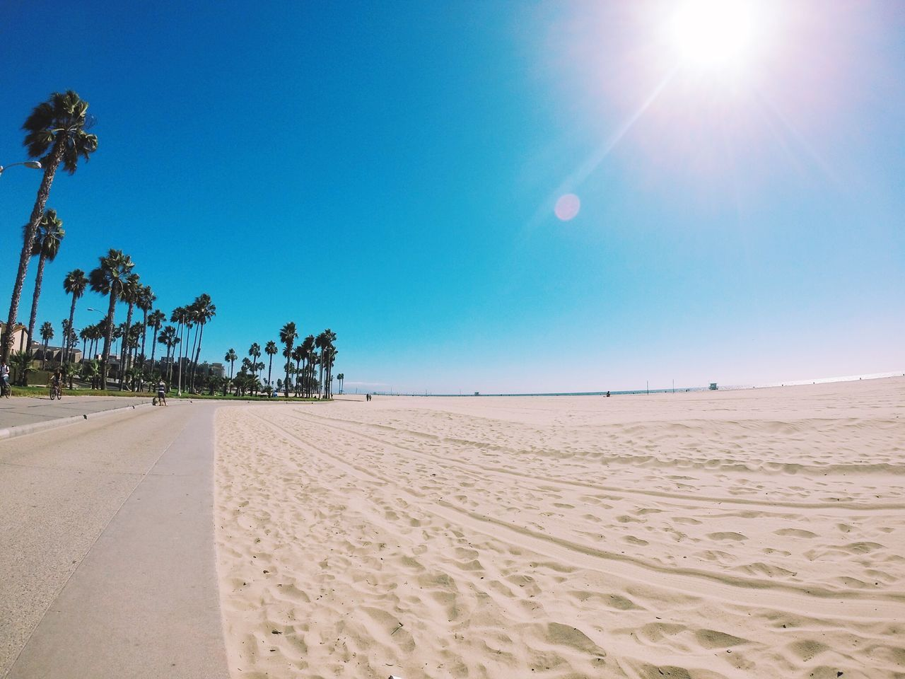 Scenic View Of Beach Against Clear Sky On Sunny Day