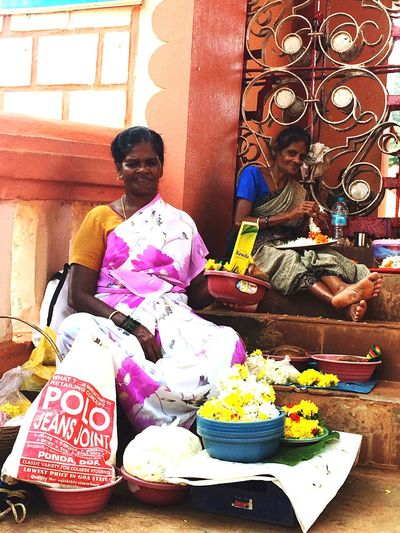 Womenoftheday making flower chains... 🌷 Flowers 🌹 India Women Of EyeEm Temple Travel Photography Traveling women
