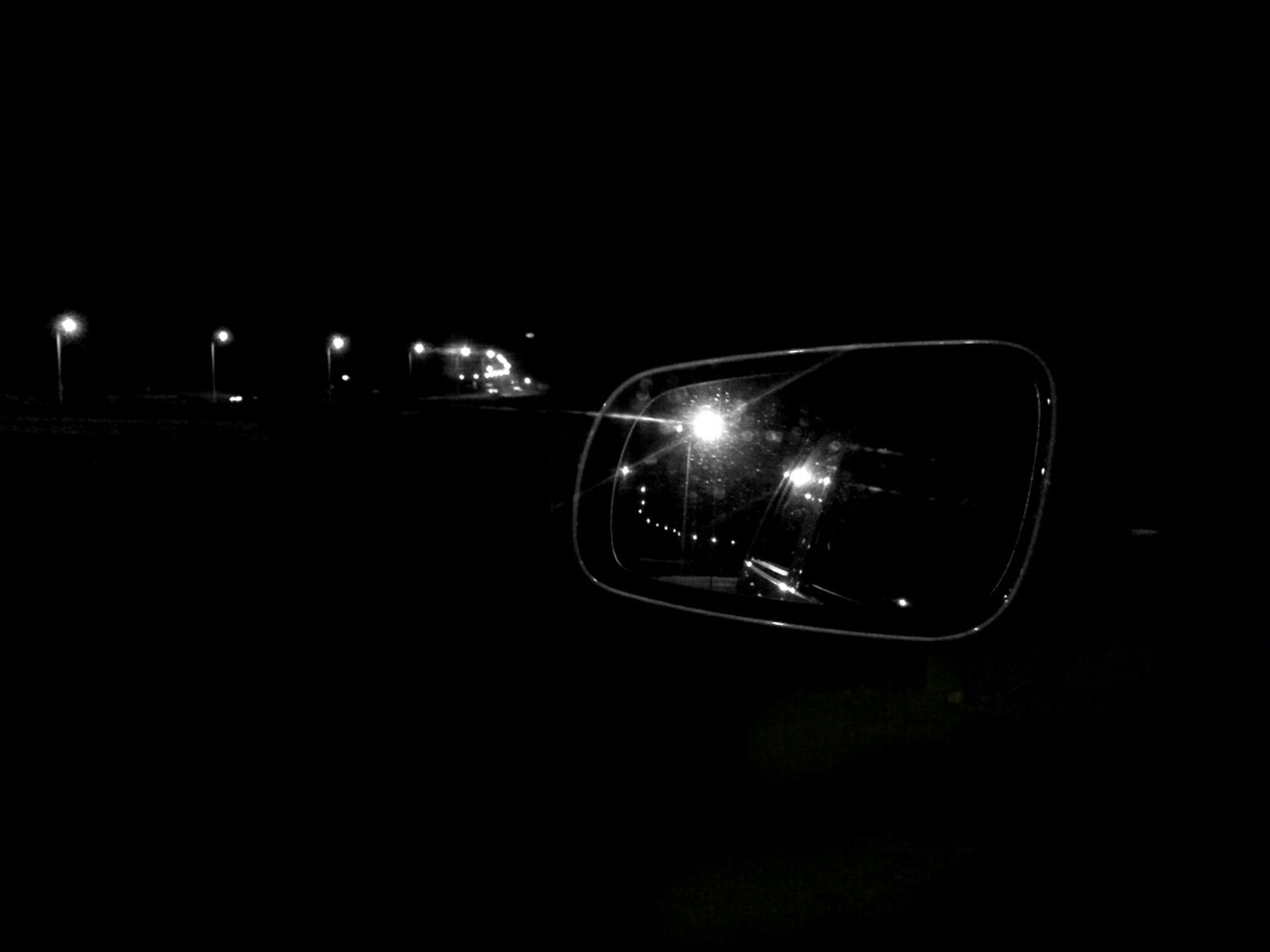 copy space, night, illuminated, dark, studio shot, close-up, car, black background, land vehicle, transportation, reflection, indoors, no people, technology, lighting equipment, retro styled, mode of transport, glowing, light - natural phenomenon, old-fashioned