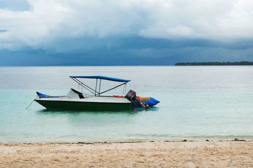 Beach Beauty In Nature Cloud - Sky Day Horizon Over Water Jet Boat Mode Of Transport Moored Nature Nautical Vessel Outdoors Outrigger Real People Scenics Sea Sky Tranquility Transportation Water