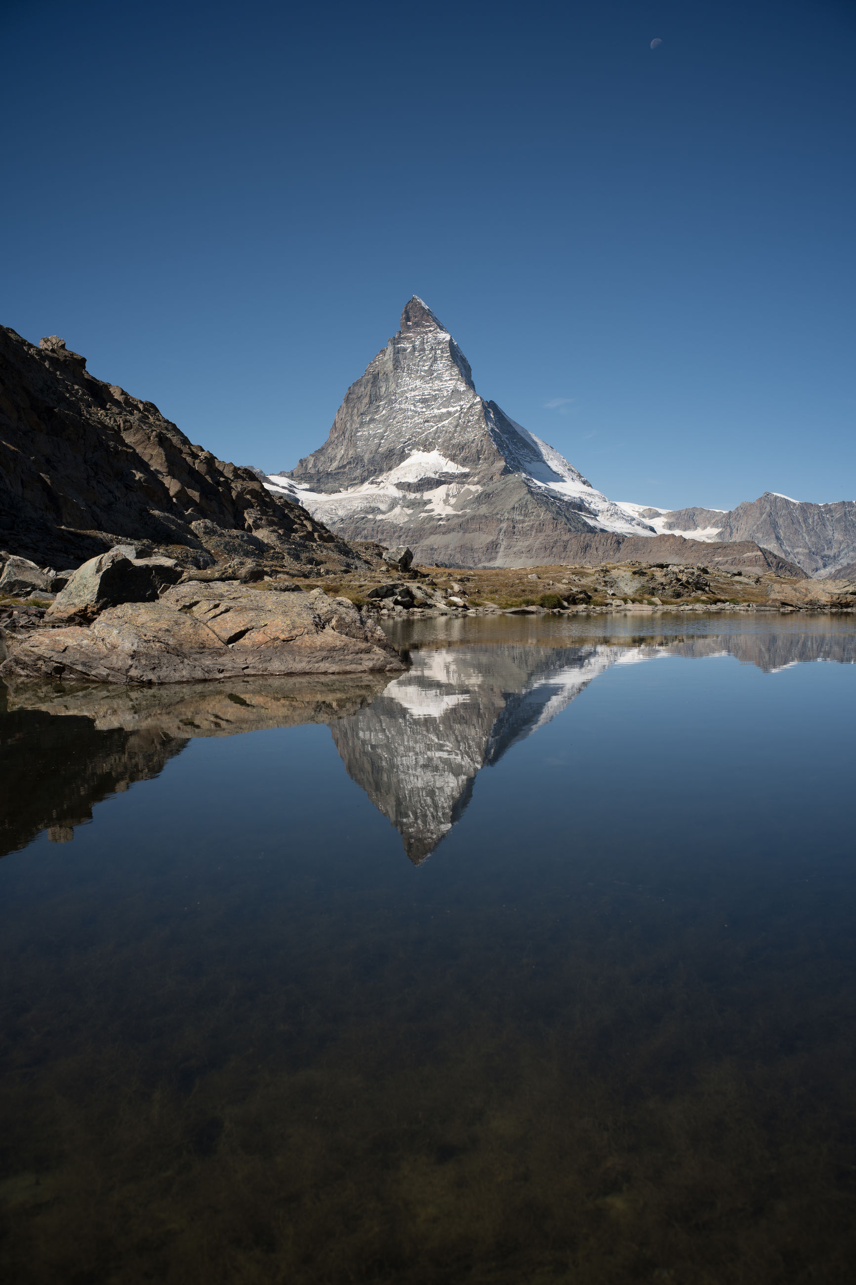 reflection, mountain, water, scenics - nature, environment, beauty in nature, sky, landscape, snow, lake, cold temperature, nature, winter, snowcapped mountain, mountain range, blue, tranquility, travel destinations, no people, tranquil scene, wilderness, clear sky, travel, mountain peak, land, outdoors, non-urban scene, ice, glacier, idyllic, sunny