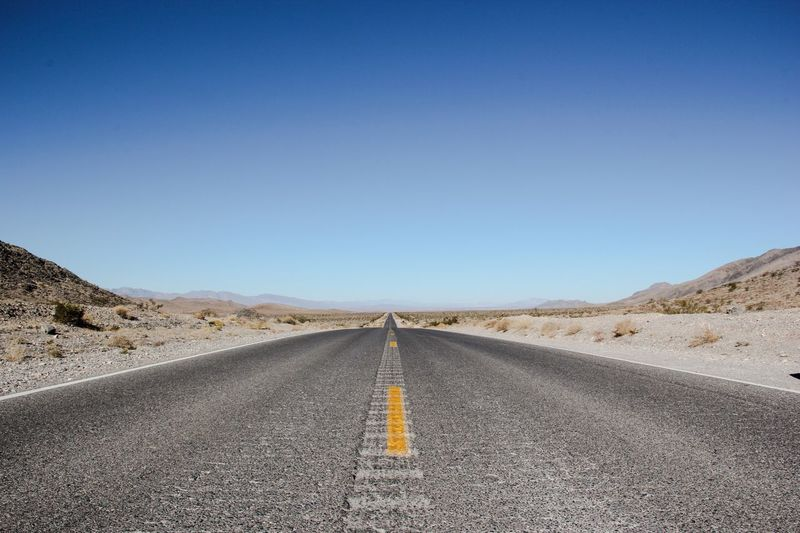 Road The Way Forward Clear Sky Copy Space Diminishing Perspective Transportation Empty Road Blue Landscape Asphalt My Year My View Death Valley Death Valley National Park Empty Day Yellow Line Tranquility Outdoors Long Surface Level Scenics Nature Miles Away