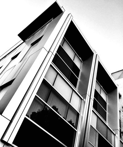 EyeEmNewHere Blackandwhite Minimalism Streetphotography Window Building Exterior Architecture Built Structure Façade Low Angle View Modern No People Outdoors City Day Sky Fashion Stories The Graphic City Visual Creativity The Great Outdoors - 2018 EyeEm Awards