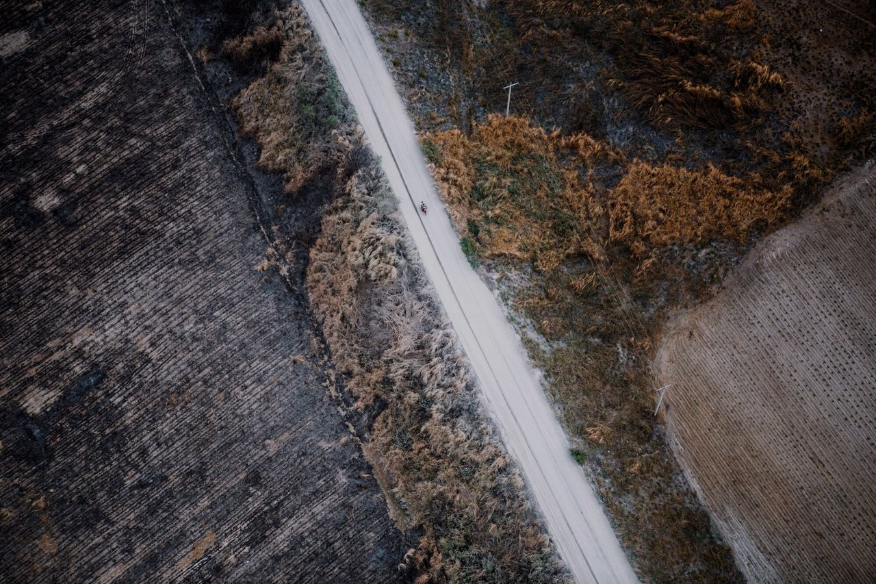Aerial shot of country road along landscape