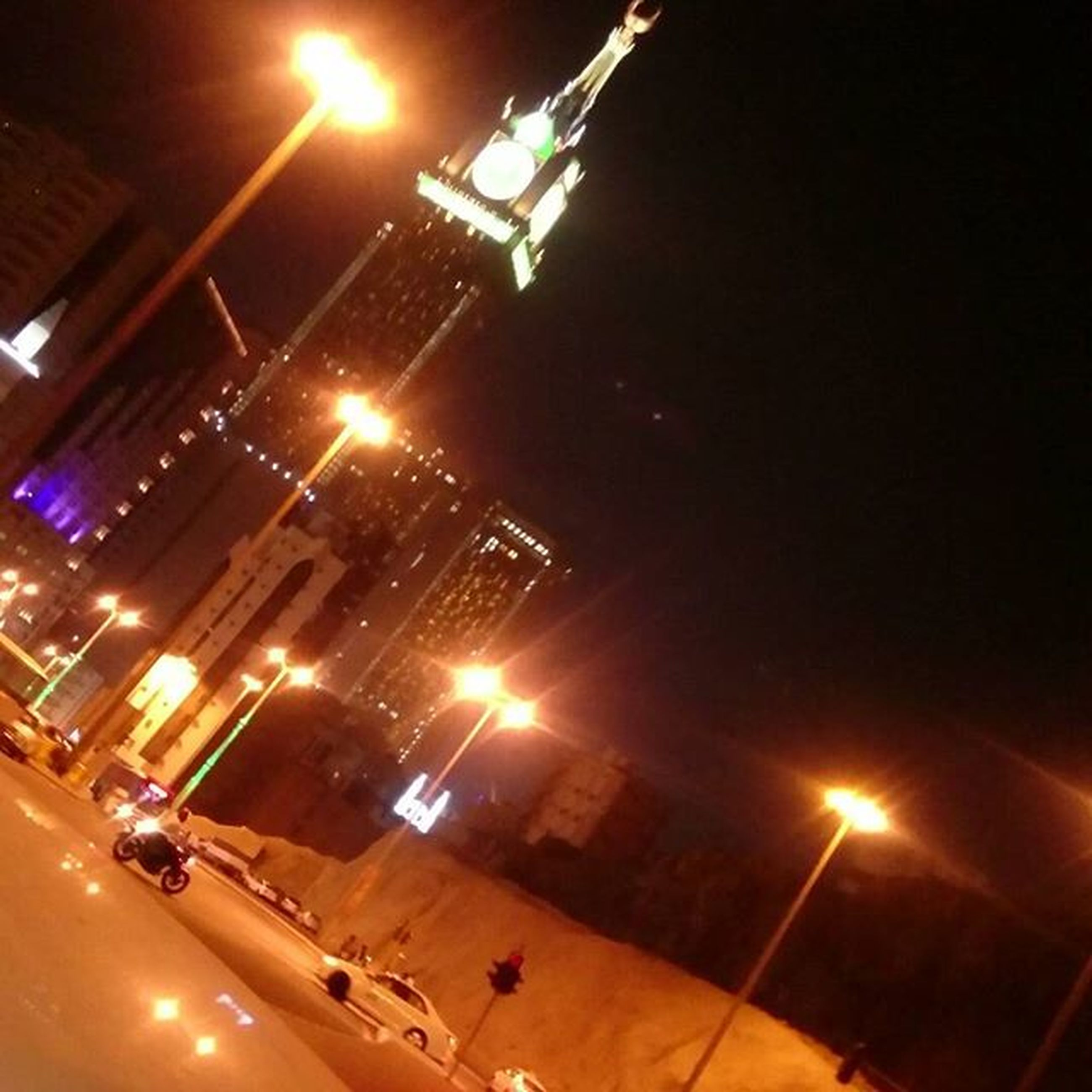 illuminated, night, architecture, building exterior, transportation, lighting equipment, built structure, city, mode of transport, light - natural phenomenon, low angle view, travel, no people, high angle view, city life, tilt, glowing, outdoors, street light, air vehicle