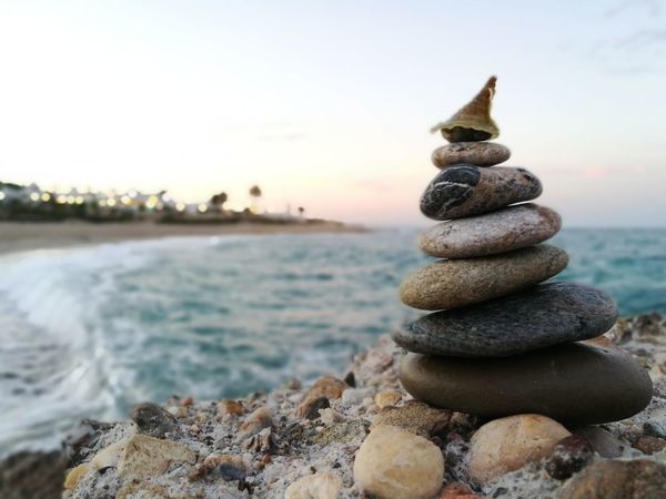EyeEm Selects Balance Sea Stack Water Zen-like Stability Beach Pebble Nature Tranquil Scene Harmony No People Tranquility Beauty In Nature Outdoors Day Scenics Close-up Sky Macro Photography Nature Photography Vacations Tranquility