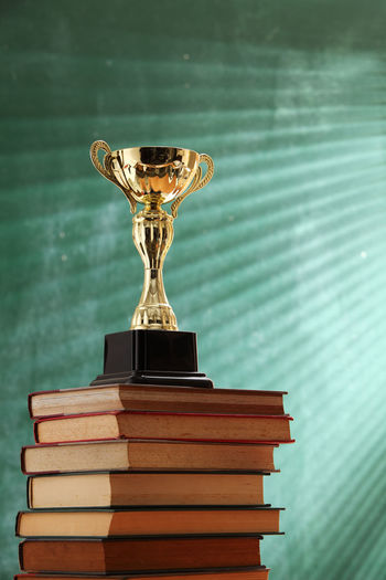Close-up of trophy on books