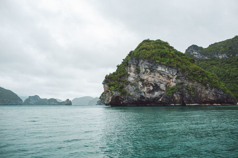 Water Mountain Scenics - Nature Sky Beauty In Nature Sea Tranquil Scene Tranquility Cloud - Sky Nature No People Waterfront Day Idyllic Land Rock Mountain Range Cliff Non-urban Scene Outdoors Turquoise Colored Formation View Into Land Bay