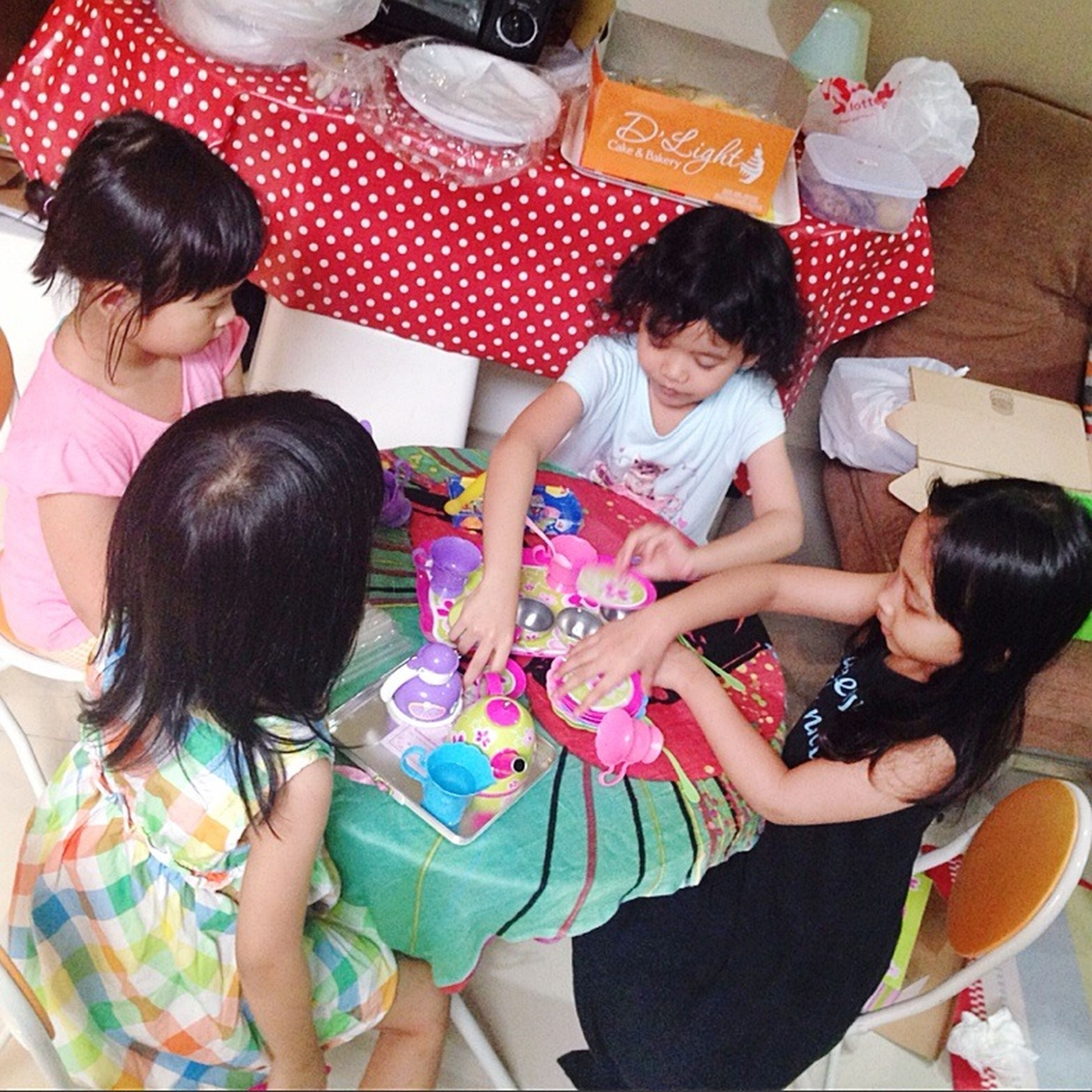 lifestyles, togetherness, childhood, leisure activity, bonding, casual clothing, people, elementary age, person, love, family, indoors, friendship, holding, sibling, enjoyment