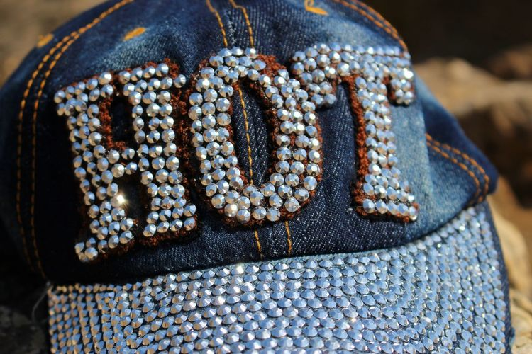 Close-up of hot text on cap