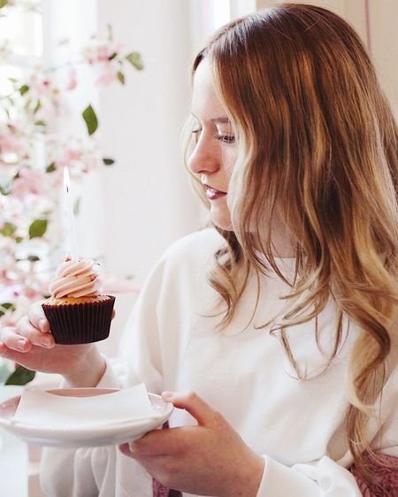 Portrait Of Young Woman With Cupcake