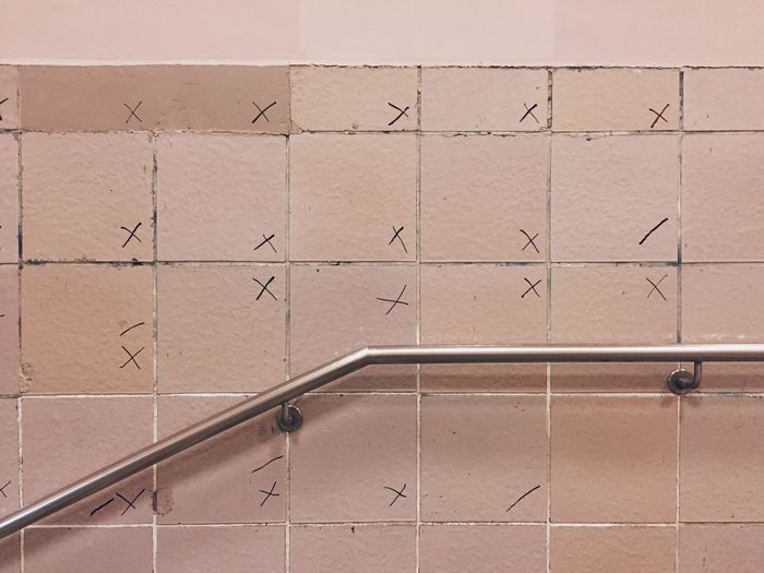 Silver metallic railing on wall