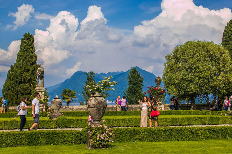 Beautiful views of the magnificent terraced italian garden of the Borromeo Palace that slope to the lake Isola Bella Lago Maggiore Palazzo Borromeo Borromean Islands Island Lake Maggiore Lake Piedmont Flowers Springtime Nature Landscape Italy Europe Travel Trees Gardening Idyllic Paradise Tourist Attraction  Card Wallpaper Park Terraced Plant Grass Tree Sky Cloud - Sky Group Of People Day Architecture Real People Green Color Field Built Structure Men Land Beauty In Nature Environment Growth People Outdoors