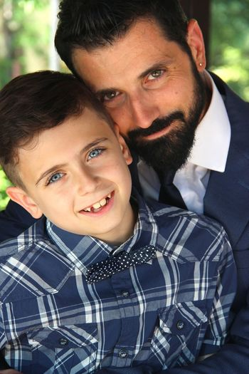 Portrait Of Smiling Man With Son