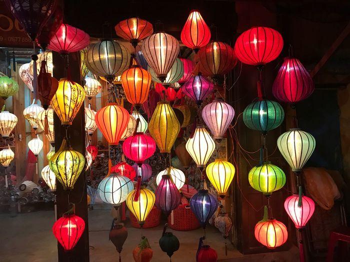Illuminated Lanterns Hanging At Night For Sale