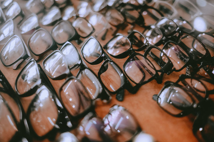 High angle view of reading glasses on the display counter