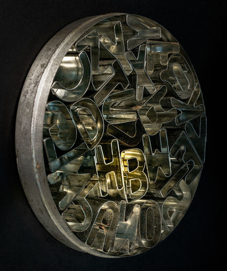 HB Indoors  Metal Close-up Studio Shot Black Background Still Life No People Directly Above Shape Geometric Shape Large Group Of Objects Circle High Angle View Glass Transportation Musical Instrument Antique Cut Out Car Wheel