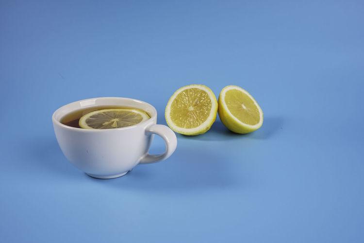 Tea cup against blue background