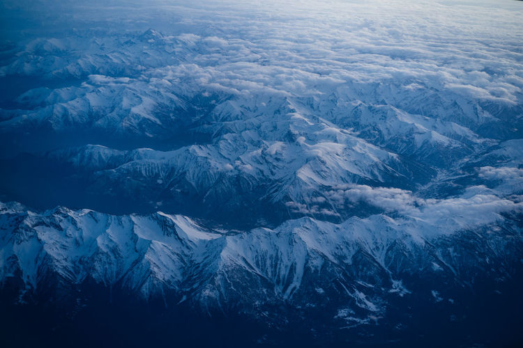 High angle view of snowcapped mountains against sky
