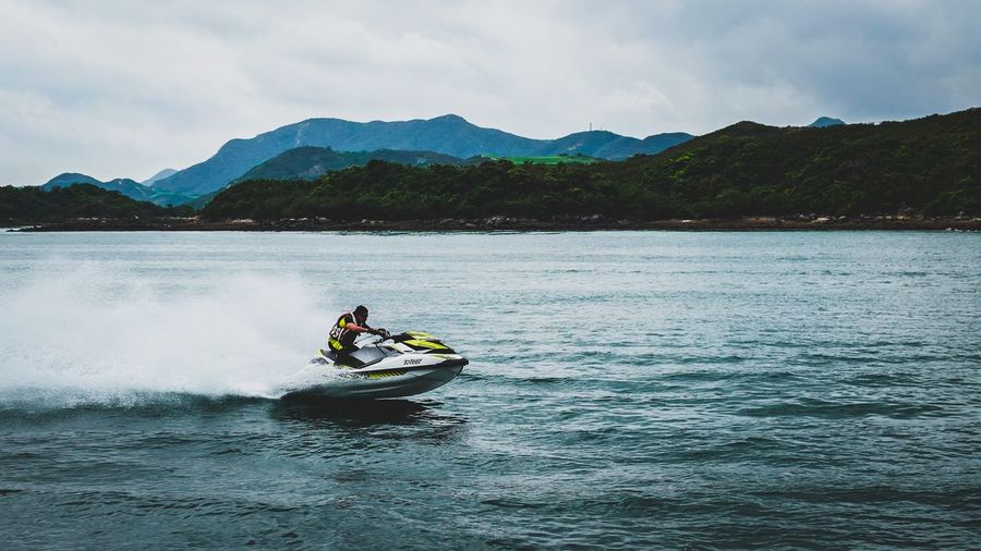 Man riding jet boat in sea