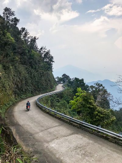 Cloud - Sky Vietnam South East Asia Motorbike Bach Ma Nationalpark Vietnam Transportation Road Tree High Angle View Mode Of Transport Land Vehicle Day Sky Winding Road Outdoors The Way Forward Mountain Nature Mountain Road Beauty In Nature