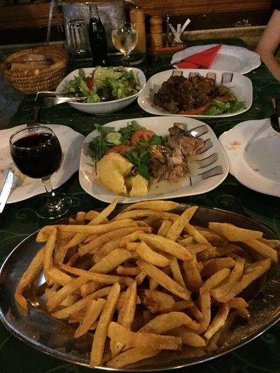 Dinner at Grada restaurant Food And Drink Ready-to-eat Lamb Chops Pork Chops French Fries Greek Salad Wine Glasses Check It Out