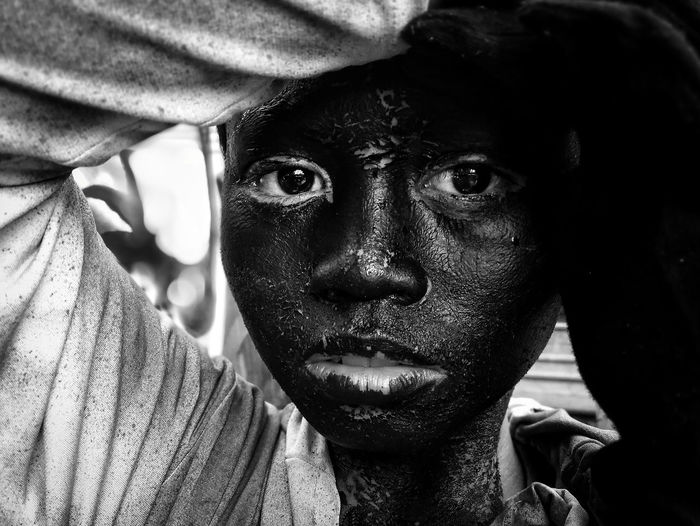 One of the dancers portraying a monkey from Pakol Festival of the Municpality of Sta. Catalina during the Buglasan Festival in Negros Oriental, Philippines. Philippines The Portraitist - 2018 EyeEm Awards Black And White Close-up Face Festival Headshot Human Face Looking At Camera Mobilephotography Monochrome One Person Portrait Real People