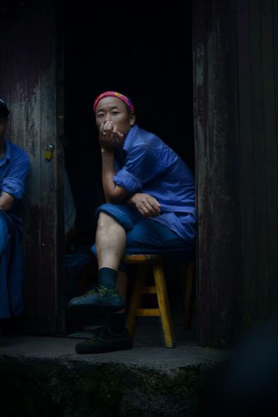 Been There. Yellow mountain china- Carriers - they are waiting to Carrie you anytime if you have any problems on top of the mountain China Been There. Yellow Mountain Carriers Forest Man Blue Sitting Chair