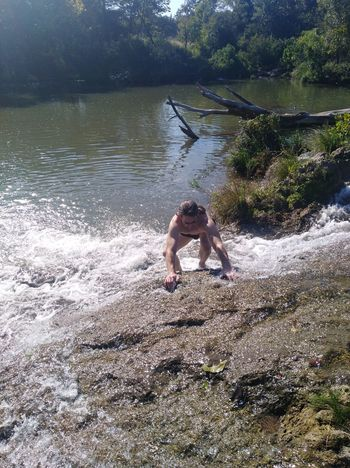 River Waterfall Man Climbing Rapid Overflowing Beauty In Nature Exciting Adventures Blue River Stone Old Stone Water Full Length Free Climbing Ankle Deep In Water