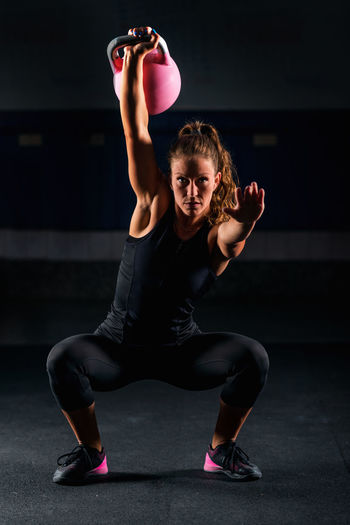 Portrait Of Athlete Exercising In Gym