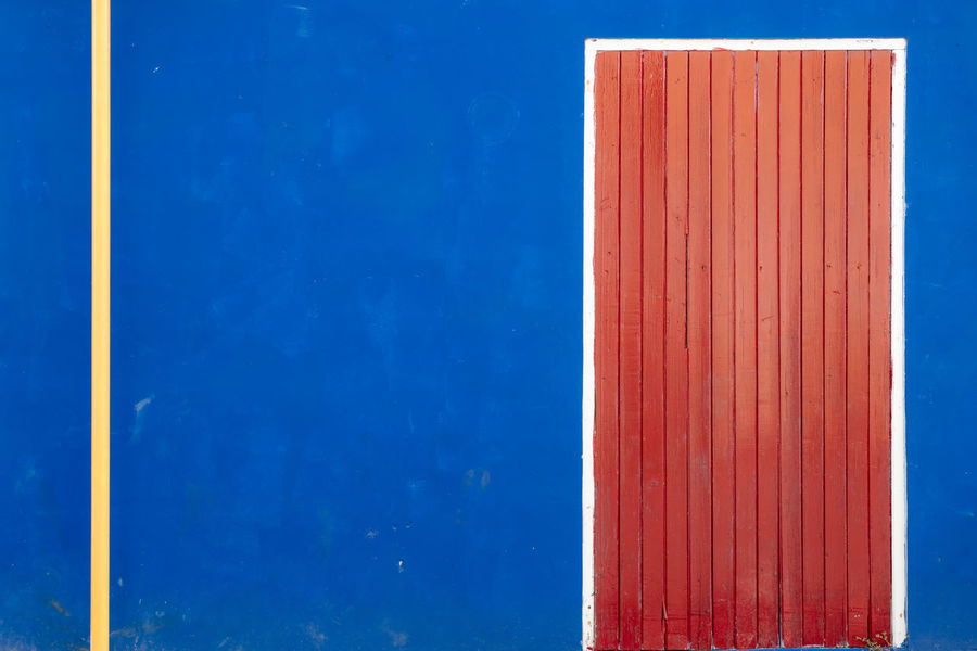 Band Red Red Door Stripes Wall White Frame Blue Blue Wall Colorful Deep Blue Door Geometricity No People Outdoor Outdoor Photography Stripe Lines White Yellow Yellow Stripe