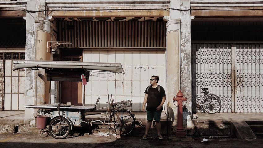 Walking past Acheen Street Ghaut. A reclaimed land back in 19th century. EyeEm Selects Only Men One Man Only One Person Adults Only Standing Full Length Adult Looking At Camera Built Structure Portrait Real People People Day Building Exterior Outdoors Architecture City Penang Georgetown Acheen Street