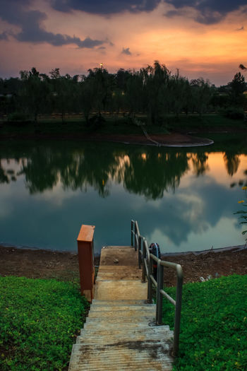 Beautiful sunset in Indonesia Water Tree Lake Beauty Reflection Sunset Sky Landscape Steps And Staircases Foggy Steps Escalator Railing Fire Escape Footbridge Bannister Staircase Tranquil Scene Spiral Stairs Idyllic Tranquility Spiral Staircase Horizon Over Water Hand Rail Stairway Spiral Stairs