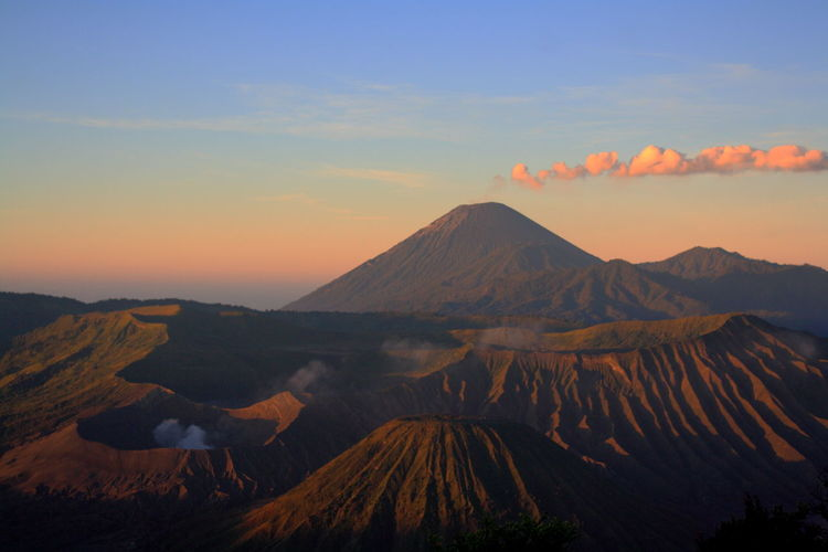 beautiful sunrise in Mount Bromo Volcanoes Beauty In Nature Bromo Mountain Cloud - Sky Day Landscape Mount Semeru Mountain Mountain Range Nature No People Outdoors Physical Geography Scenics Sky Sunset Tranquil Scene Tranquility Travel Destinations Volcanic Landscape Volcano