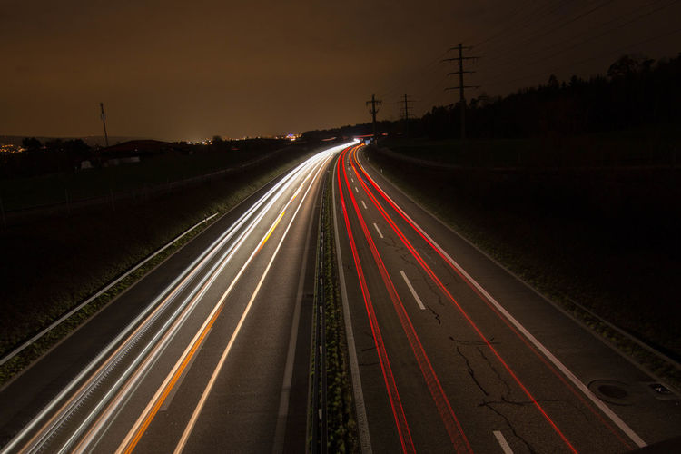 EyeEmNewHere Night Light Trail Long Exposure Speed Illuminated Motion Street Light Lighting Equipment Transportation Traffic Car Bridge - Man Made Structure Highway Vehicle Light Multi Colored Outdoors City Life Travel Destinations City Neon Light Perspectives On Nature