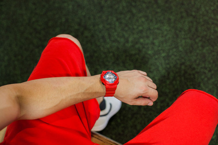 Adult Body Part Close-up Day Finger Focus On Foreground Hand Human Body Part Human Hand Leisure Activity Lifestyles Men One Person Personal Perspective Real People Red Sport Time Watch Wristband Wristwatch