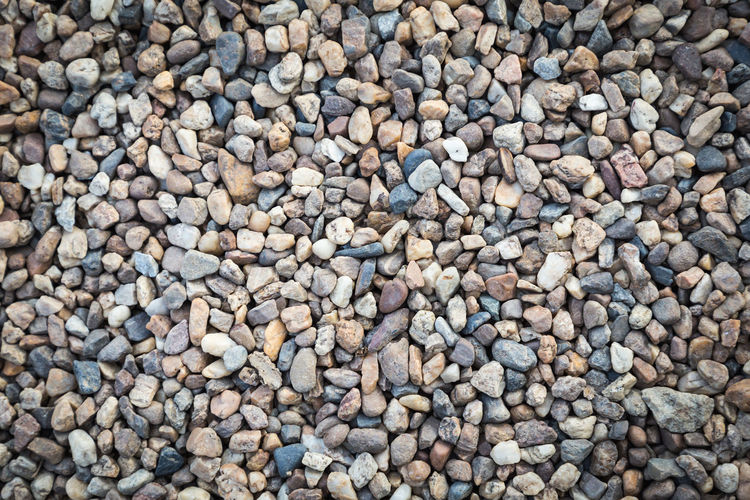 Stone pebbles texture background for interior exterior decoration and industrial construction concept design Stone Pebbles Sand Background Texture Slate Table Grey Abstract Surface Rock Granite Marble Wall Floor Tile Board Nature Old Closeup Bright Retro Material Rough Mineral Cave Light Wallpaper Architecture Home Construction Brick Modern Castle Backdrop House Urban Structure Grunge Detail Antique Pavement Cobblestone Conservatory Road Street Paving Perspective Garden Large Group Of Objects Pebble Full Frame Stone - Object Abundance Backgrounds Solid No People High Angle View Directly Above Beach Textured  Day Still Life Land Close-up Outdoors Textured Effect