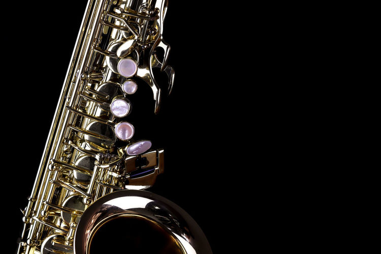 Music Instrument Alto Saxophone, Saxophone Isolated on black Musical Instrument Studio Shot Music Black Background Wind Instrument Arts Culture And Entertainment Indoors  Copy Space Metal Shiny No People Cut Out Saxophone Brass Instrument  Single Object Gold Colored Close-up Reflection Brass Musical Equipment Silver Colored