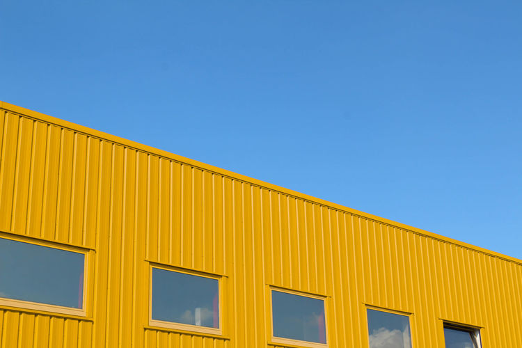 the L I N E Paint The Town Yellow Yellow Urban Geometry Minimalist Architecture Outdoors Blue Day No People Sky Building Exterior Architecture Built Structure Minimalism Lines Window The Architect - 2018 EyeEm Awards