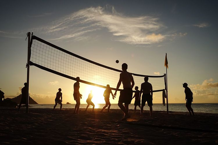 Sunset volleyball in St Lucia Sea Beach Sunset Men Playing Holiday Outdoors Competition Beach Volleyball Ball Teamwork Volleyball - Sport Silhouette Sky Leisure Activity Lifestyles Sport Enjoyment Nature Sand Friendship Team Sport Group Of People Sports Team People