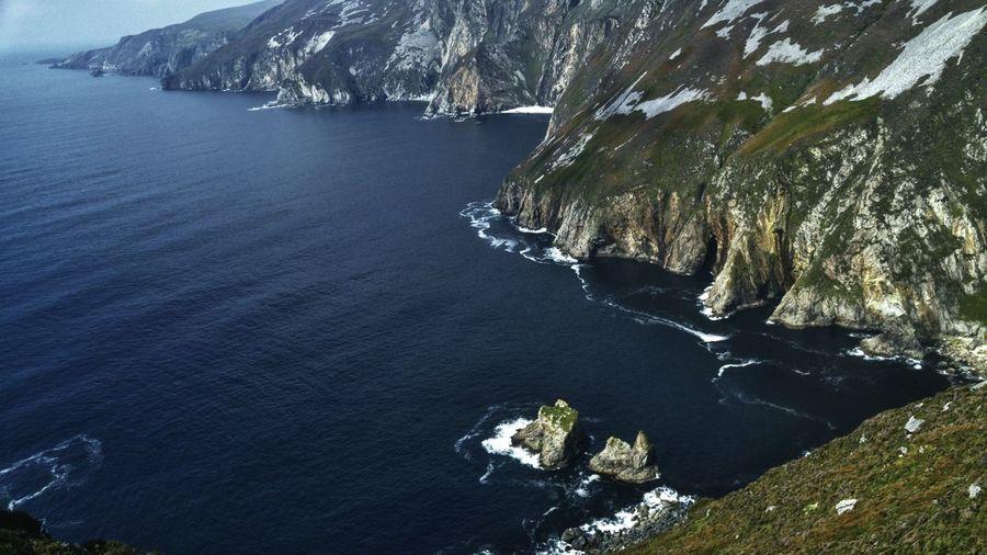 High angle view of rocky coastline