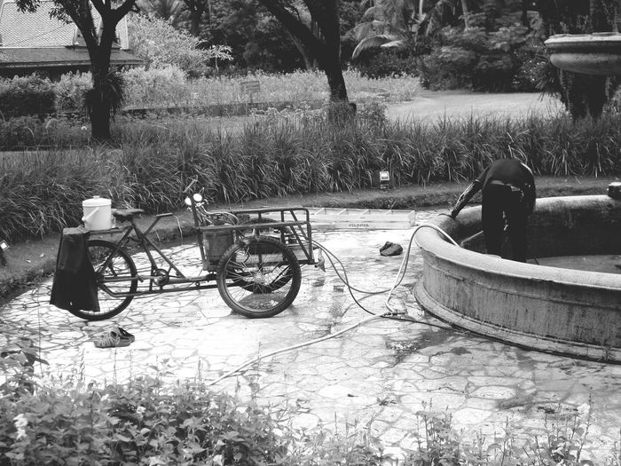 Man relaxing on bicycle in park
