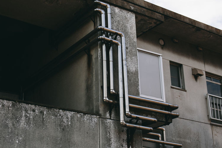 Outdoors Built Structure Architecture Building Exterior Window Building No People Low Angle View Day Wall - Building Feature Old Residential District Wall Pipe - Tube Metal City Lighting Equipment House Nature Abandoned Apartment
