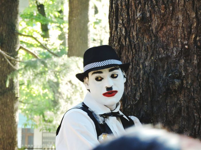 The Week on EyeEm Man Entertainment Hat Streetphotography Adult Expression Tree Portrait Clown Disguise Smiling Close-up Venetian Mask Mask Red Lipstick Mask - Disguise Anthropomorphic Face Carnival - Celebration Event Mime Costume Eye Mask Superhero Lipstick Carnival