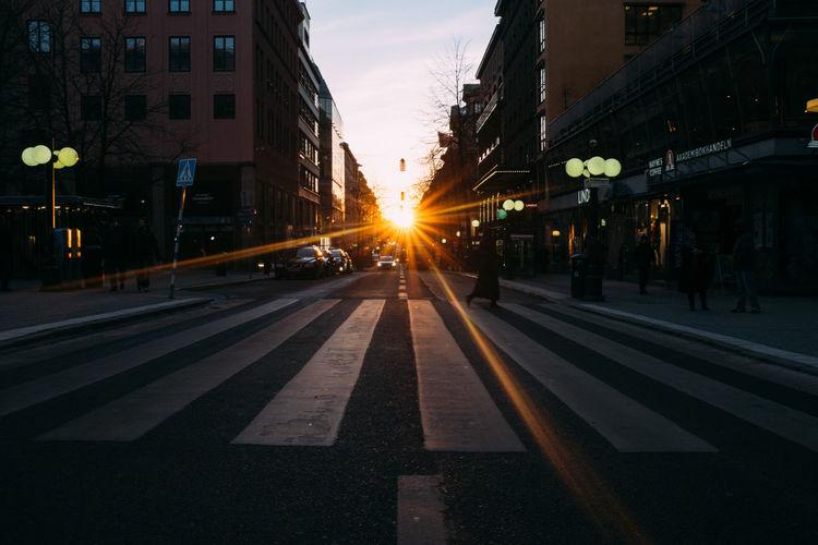 City street against sky at dusk