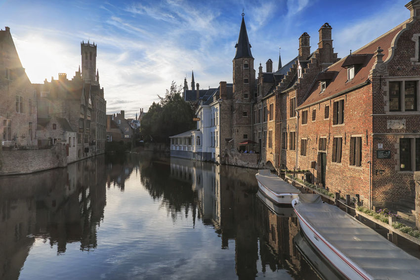 "Bruges, Belgium - July 7, 2017: Scenery with water canal in Bruges, ""Venice of the North"", cityscape of Flanders, Belgium at sunset Beer Belgium Brugge Chocolate Dijver Canal Duvel Flanders Panoramic View Provinciaal Hof West Flanders Aerial View Belfry Tower Bikes Bruges Europe Flower French Fries Holland Market Square Medieval Town Mussels"