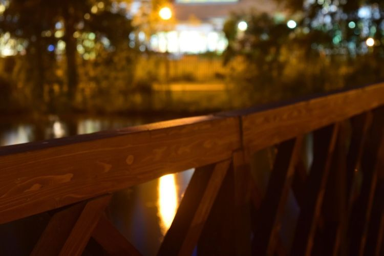 Illuminated Night Focus On Foreground No People Railing Nature Wood - Material Water Close-up Outdoors Reflection Architecture Built Structure Connection Light - Natural Phenomenon Selective Focus