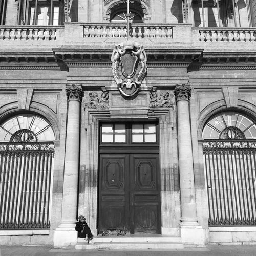 Hôtel de Ville Blackandwhite Dogandman Dogs Dog Architecture Built Structure Building Exterior Day Outdoors Arch One Person One Man Only Adults Only Adult People Real People First Eyeem Photo