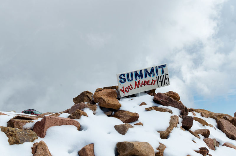 Cloud Cloud - Sky Cloudy Cold Temperature Colorado Springs Day Hiking Low Angle View Outdoors Pikes Peak Summit Season  Sky Snow Text Tranquil Scene Tranquility Weather Western Script Winter
